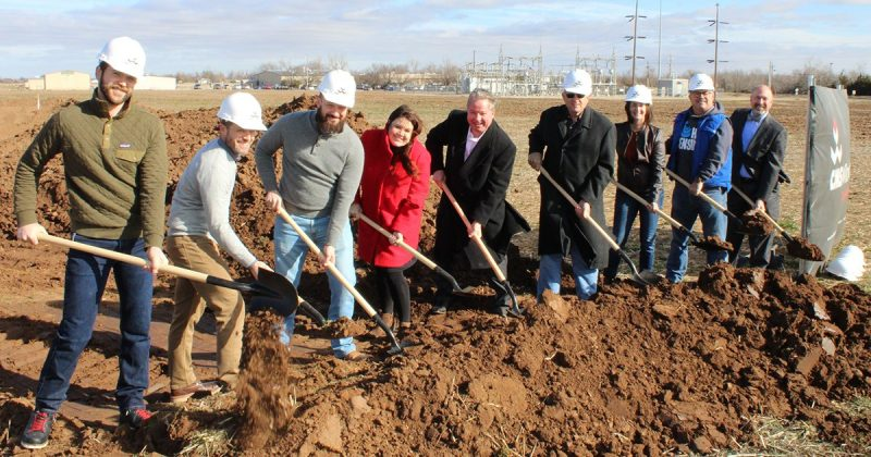 A group of people with shovels at a groundbreaking ceremony