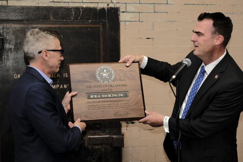 Governor Stitt presents plaque to Rural Sourcing