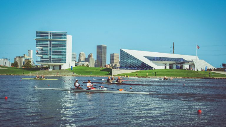 Rowers on the North Canadian river in Oklahoma City in the river sports district and the Oklahoma City downtown skyline in the background